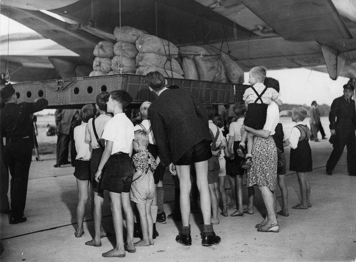 C-74_Globemaster_unloading_flour_at_Berlin_Gatow_during_Operation_Vittles-1.jpg